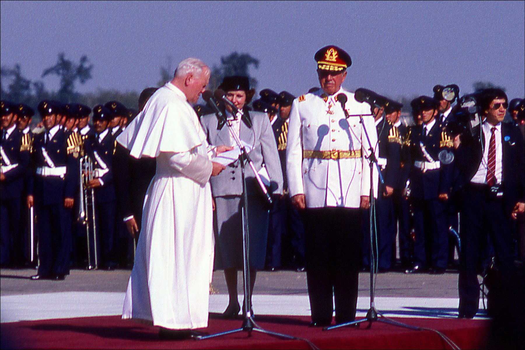 Photo of Pope John Paul II on a papal visit to Chile, here making a speech in the presence of former Chilean dictator Augusto Pinochet.(for National Geographic Magazine)