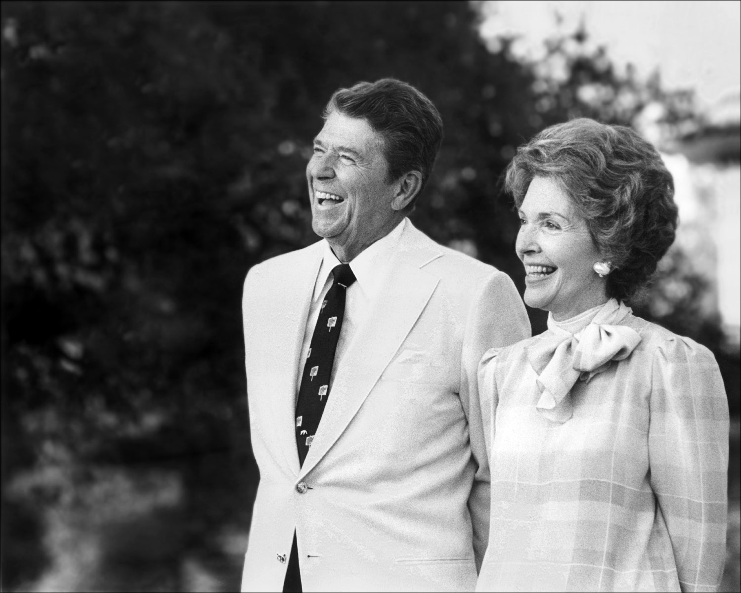 Photo of President Ronald Reagan and wife, Nancy, as they address guests at a private gathering in Hope Ranch, an exclusive enclave in Santa Barbara, California.