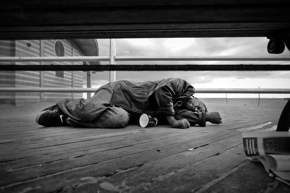 Sleeping it off on the boardwalk on a warm autumn day. Yunghi Kim ©2014.