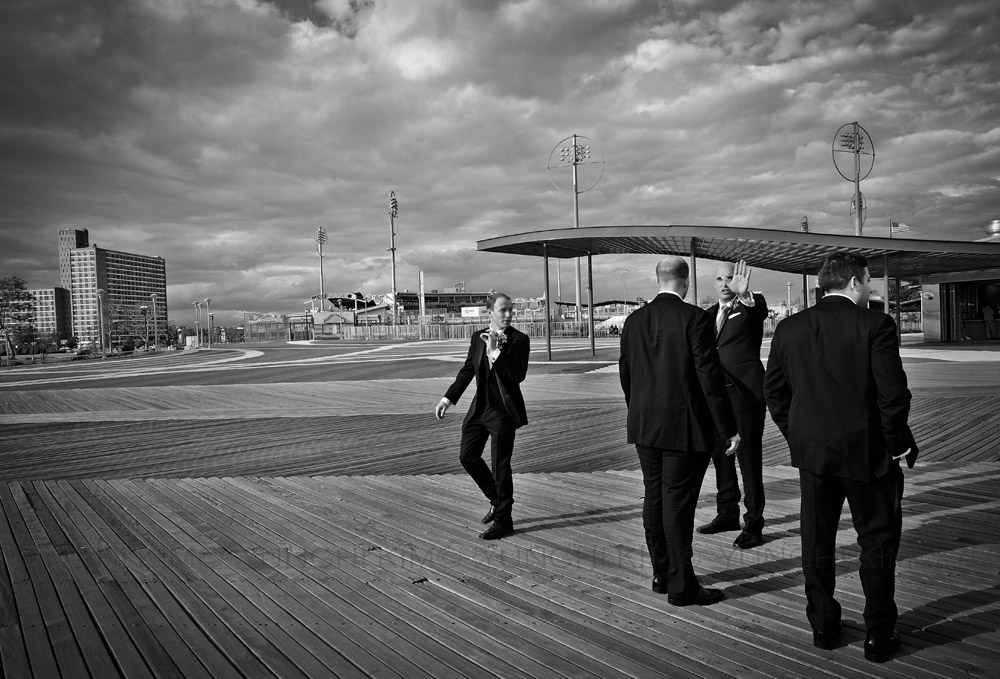 Groomsmen from a wedding party. Picturesque board walk is a good back drop for photographers. Yunghi Kim ©2014.