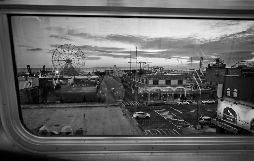 Millions of visitors get to Coney Island boardwalk by subway. View as you enter Coney Island from Q subway train. Yunghi Kim ©2014.