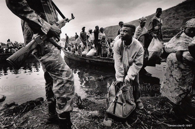 Residents who had fled Goma, to escape the fighting have their bags searched upon returning home.