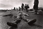 A soldier's body lies on the road in Mugunga camp. Old Hutu government soldiers in the camp massacred refugees in attempts to keep the refugees from returning home to Tutsie-controlled Rwanda.