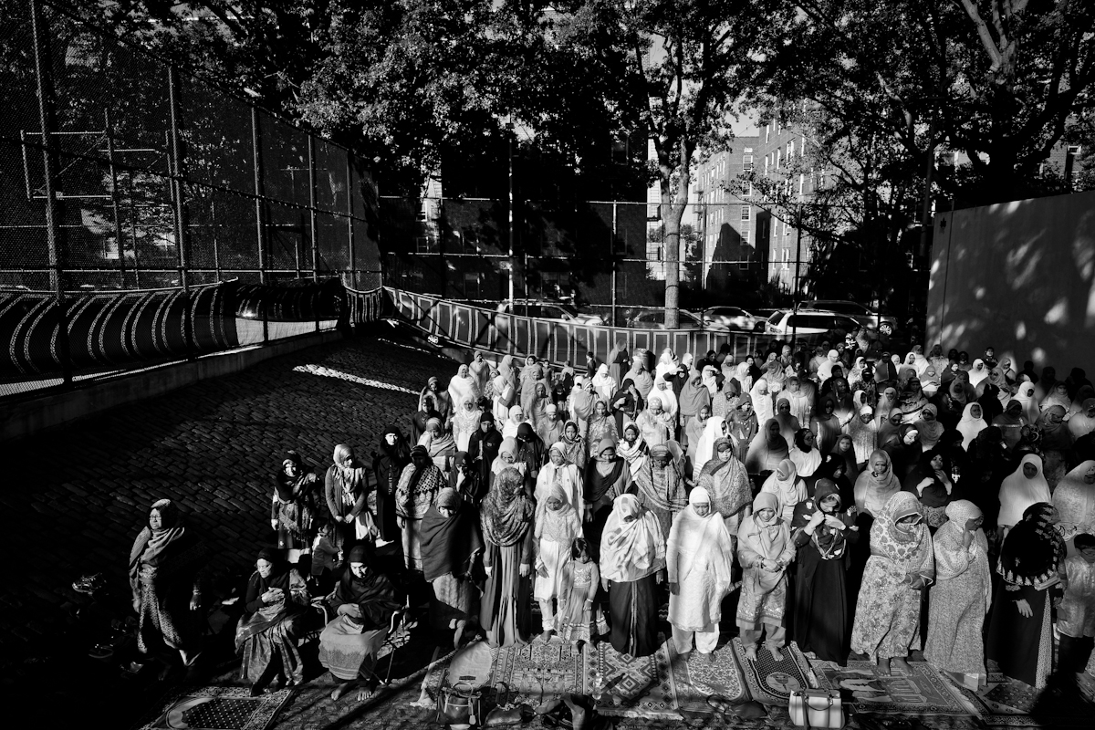 9/24/15 NY Neighborhood profiles series.  Jackson Heights Queens.Travers Park, morning Eid prayer. Women section is a handball court . © 2015 Yunghi Kim/Contact Press Images.