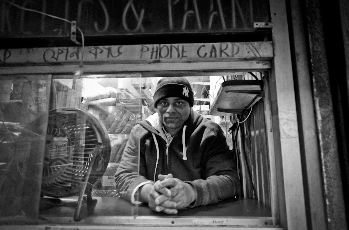 12,9,2015 Jackson Heights Queen. Neighborhood profile. Store owner, Mohamed Islam at his the store he's had  since 2001, near Roosevelt Ave subway stop. He's emigrated from Bangladesh in 1987. © 2015 Yunghi Kim/Contact Press Images.