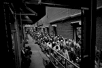 12,11,2015 NY Neighborhood profiles series.  Jackson Heights Queens. Friday prayer at Darul Hidayah Mosque in Little Bangladesh section. Payers spilled over to alley outside the mosque on 73 rd Street. © 2015 Yunghi Kim/Contact Press Images.