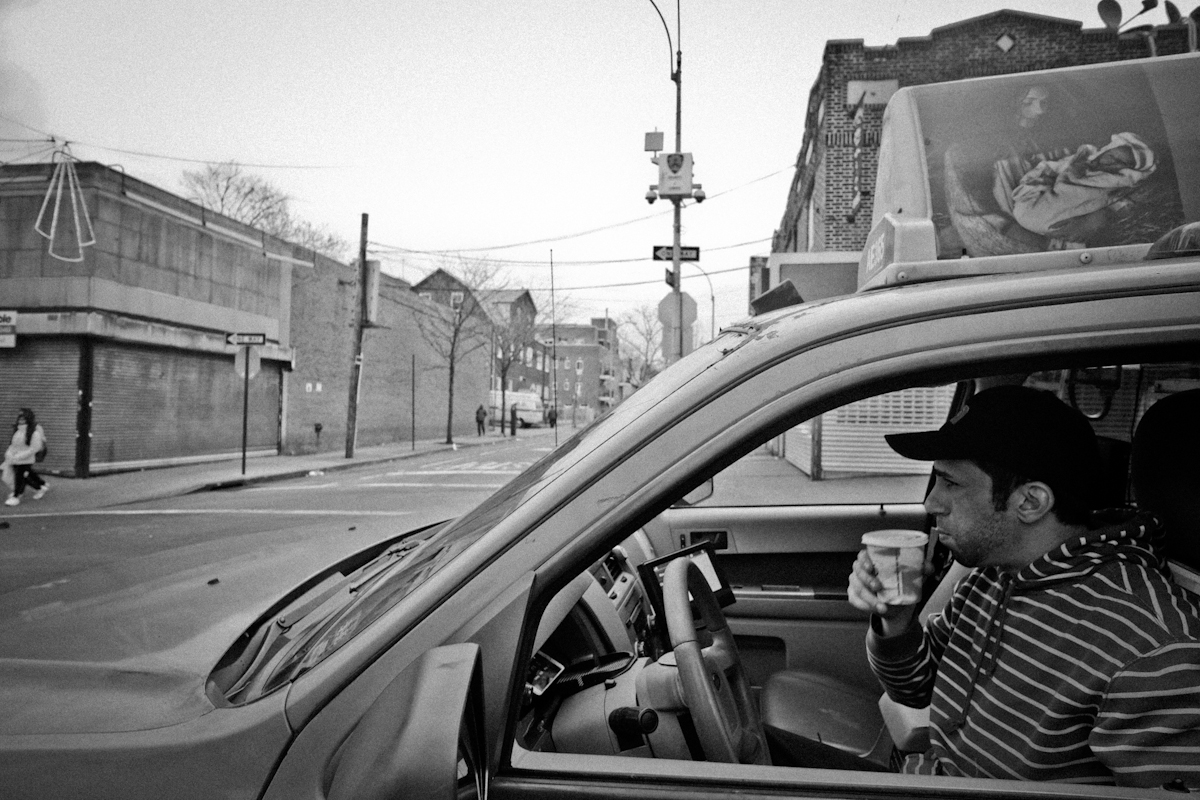 12,9,2015 NY neighborhood series. Jackson Heights Queen. Taxi driver Khaleed Ibrahim waits for a passenger at Roosevelt Ave subway stop. He's from Egypt. © 2015 Yunghi Kim/Contact Press Images.