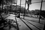 9/24/15 NY Neighborhood profiles series.  Jackson Heights Queens. Travers Park, morning Eid prayer. A child plays in a swing nearby. © 2015 Yunghi Kim/Contact Press Images.