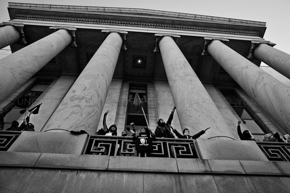 OWS and other Occupiers from alll over the country gather at the US Capital for Occupy Congress.  Here protesters are jubilant after briefly taking over the balcony of Rayburn Building, Washington DC.