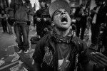 Occupy Wall Street gather at Zuccotti Park after winter break. Here a former US Marine Harold Gonzalez screams in protest.  The police have clampdown on protesters in 2012, not uncommon for many protesters have been arrested 7 or 8 times.
