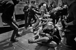 Protesters tries to shutdown NYC at May Day protests. Undercover and uniformed NYPD scrambles to nab protesters using Blac Bloc tactics, as other protesters try to rescue her from NYPD's grip.