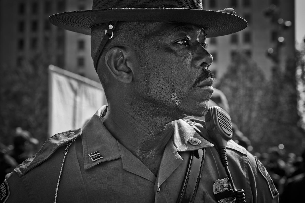 The Republican National Convention, Cleveland Ohio 2016. Blistering heat, an officer 's sweat streams down his face. ©2017 Yunghi Kim/ Contact Press Images