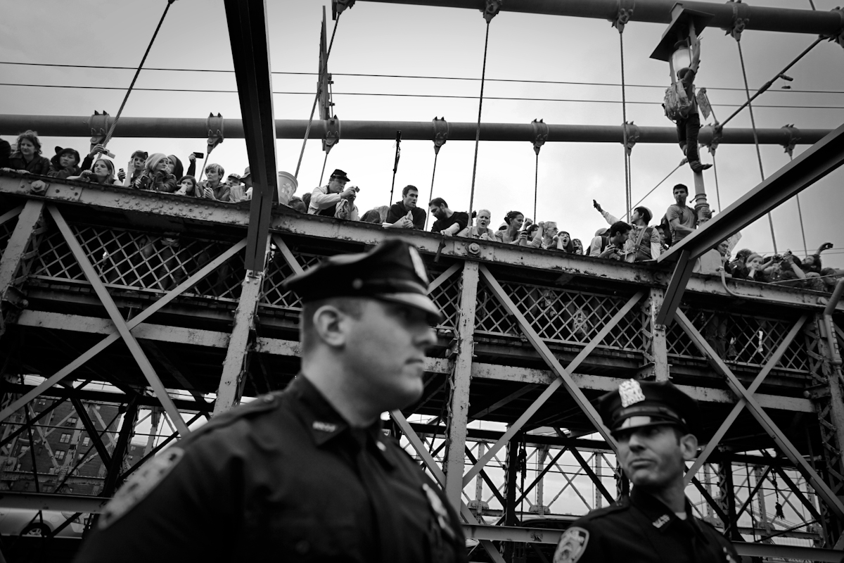 Anticipation of impending mass arrests on Brooklyn Bridge NYC, protesters climbed to the upper level of the bridge to avoid arrest. 700 were arrested including many journalists. Anyone who stayed on the bridge were arrested, Occupy Wall Street 2011. ©2017 Yunghi Kim/ Contact Press Images