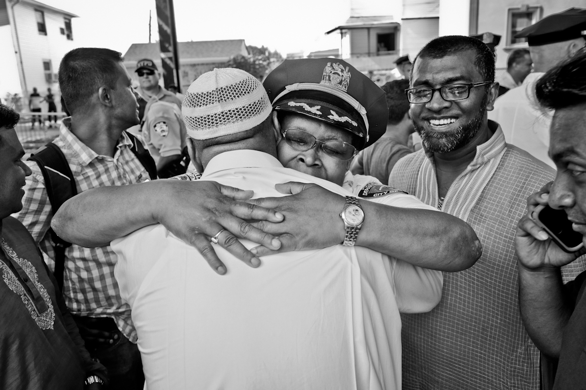 Ozone Park, Queens NY. 8/ 15/16  Shooting death of Imam Maulama Akonjee 55 years old and assistant Thara Uddin 64 years old  were shot dead in broad daylight August 13, 2016 in the Ozone Park neighborhood. Ozone Park is largely Bengali community was in shock and scared. NYPD lieutenant hugs a community member, after a peaceful protest.