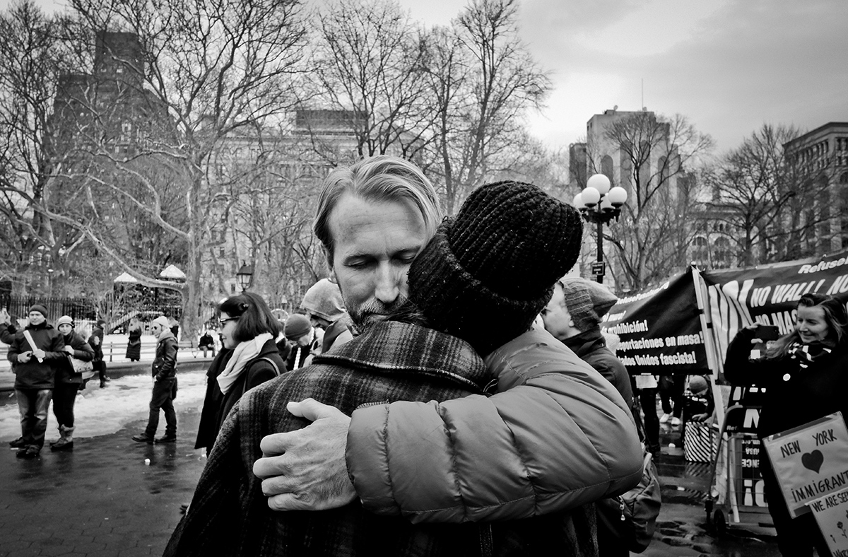 FEB 11,  2017. Immigration protest, Washington Square Park, NYC Edward Sullivan in private moment in the midst of immigration protest and street musicians playing piano.