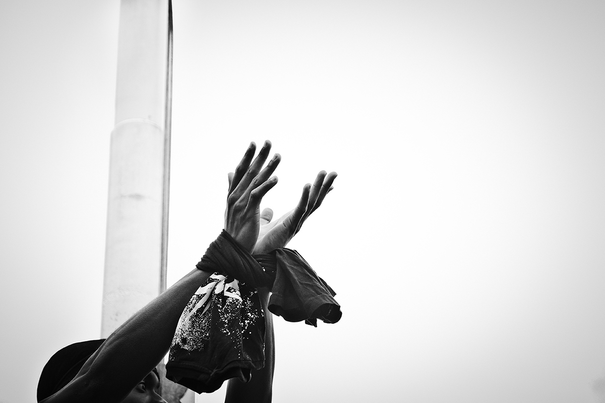 6/2/20 Barclays Center, Downtown Brooklyn.   Protests  against the the death of George Floyd, a black man who was killed in Minneapolis police custody on May 25.  GarySpringer 23 years old from Brooklyn emotion at the end of the protest.  His hands tied to show repression. Photo by Yunghi Kim/ Contact Press Images
