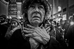 A woman gestures choke Hold during a protest at the NYC's Grand Central Station. Eric Garner, who had asthma when NYPD placed him in what appears to be a chokehold. Garner, 43, can be heard gasping, {quote}I can't breathe!{quote}