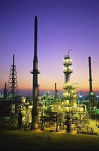 Walking through an oil refinery you can't helpbut think of dinosaurs.Old oil.Old technology.A beautiful place at twilight.