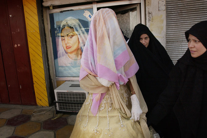 A bride leaves a beauty salon with her face covered; she will not show herself until she reaches the privacy of a family gathering. The Mahdi Army have threatened beauty salon owners advertising pictures of women without their hair covered. Mahdi fighters police neighborhood streets, enforcing strict moral codes.