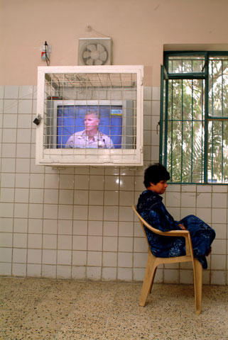 A female patient is disinterested in a live broadcast by American General Richard Myers.