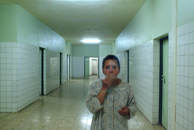 Siham, a patient at Rashad Psychiatric Hospital, smokes in the Ibn Omran Women's Ward.