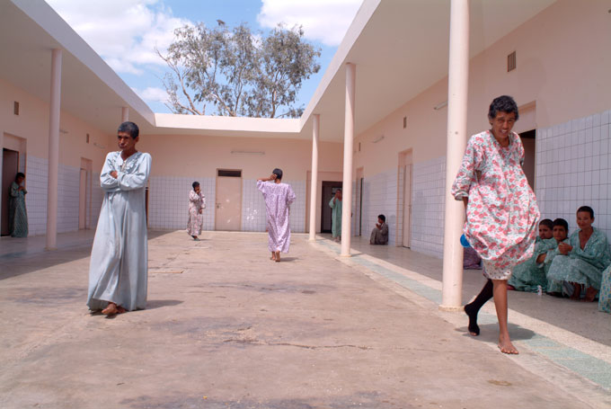 Female patients pace the courtyard in the Zenab Women's Ward of the Rashad Psychiatric Hospital.