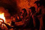 In the mountains between Turkey and Iraq, Kurdish smugglers settle down for the night in a hidden cave along the Tigris River.