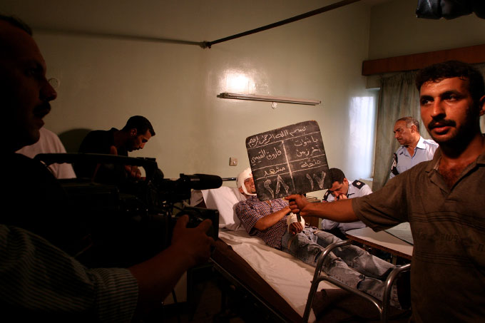 An Iraqi television crew prepares to film a scene for a soap opera based on Iraqi daily life. A new art scene effected by the war and violence is flourishing in Baghdad.