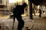 Members of the Mehdi Militia run for cover during a gunfight  with Iraqi police during the three-week siege of Najaf.