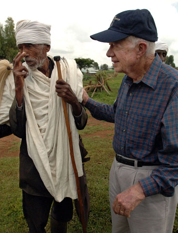 Former US President Jimmy Carter tours a village in Ethiopia where The Carter Center has worked in an effort to eradicate Trachoma.