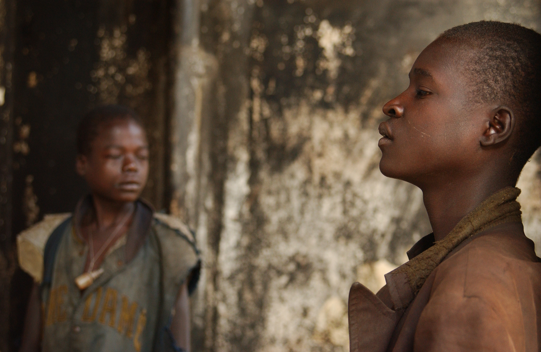 Rebels from the Lord's Resistance Army abducted Anywar Walter and his three brothers along with several hundred other people in Pajule, Northern Uganda. The rebels split the brothers into different groups and brought Walter to Sudan where he joined Joseph Kony's group. While in Sudan his younger brother was killed in a battle with the Ugandan Army and he does not know what happened to his other brothers. Behind him is Ojok Charles who was abducted with his cousin who was also killed by the Ugandan Army. They are being held at the Army Child Protection Unit in Gulu after escaping from the rebels. Uganda.