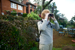 Annie Sevier  bird watches at Sunbird Ku Chawe Hotel in Zomba, Malawi. 4/8/2009. ©Vanessa Vick