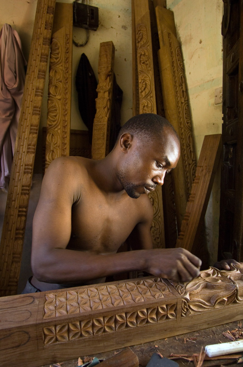 Lenox Ahmad makes a wood doorframe in Stone Town on the island of Zanzibar in Tanzania. Zanzibar is famous for elaborately hand carved wooden doors. January 16, 2007©Vanessa Vick