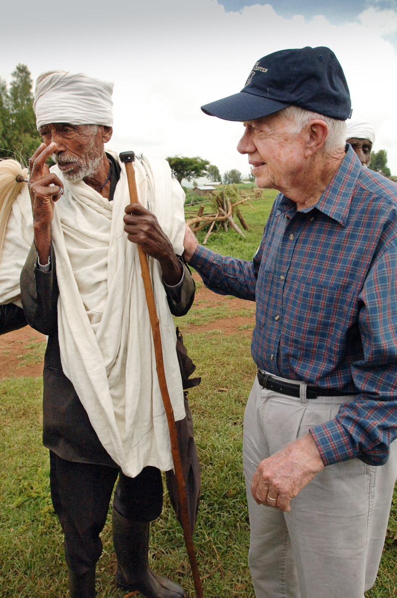 Former US President Jimmy Carter his wife Rosalynn Carter and a delegation tour Mosebo a village in Ethiopia where The Carter Center has worked in an effort to eradicate Trachoma. The Carter Center's goal was to have 10,000 latrines built in rural villages in order to reduce the number of flies the program became so popular that over 90,000 latrines were constructed. Trachoma is the leading cause of preventable blindness worldwide. It is caused by infection with Chlamydia trachomatis bacteria, making it both treatable and preventable. The advanced stage of trachoma trichiasis, the inward turning of eyelashes that leads to corneal abrasion and eventual blindness causes extraordinary pain and discomfort to the sufferer. Women are approximately three times more likely to have trichiasis than men. Surgery is used to reverse the in turned eyelashes of patients with trichiasis.  Mosebo Ethiopia September 15, 2005. (Photograph by Vanessa Vick)