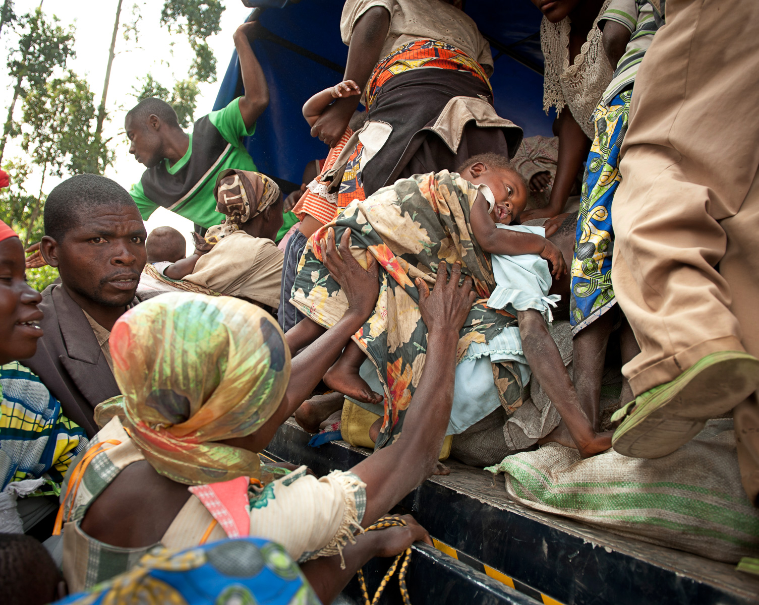 Refugees from the Democratic Republic of Congo flee the civil war with the rebel group M23. They are desperate to get on a Ugandan police truck at the border town of Bunagana that will carry them the remaining distance to the Nyakabanda transit site in Kisoro, Uganda. Most of these refugees will be resettled at Rwamwanja, Uganda after the UNHCR has registered them.