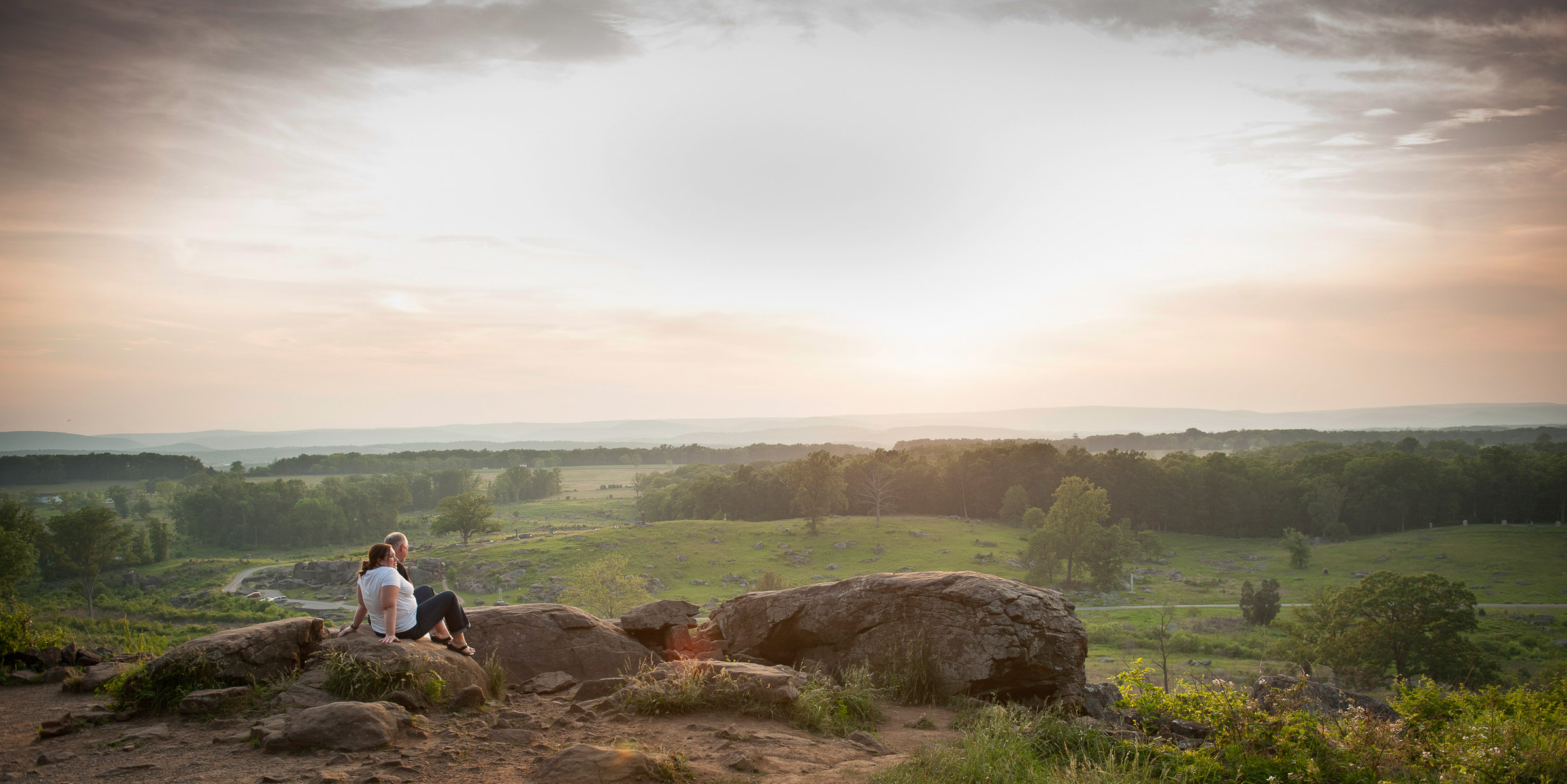 Visitors enjoy the sunset at Little Round Top one of the most scenic sites on the 24-mile auto tour winding through the Gettysburg National Military Park in Pennsylvania. May 30, 2013. VANESSA VICK FOR THE NEW YORK TIMES