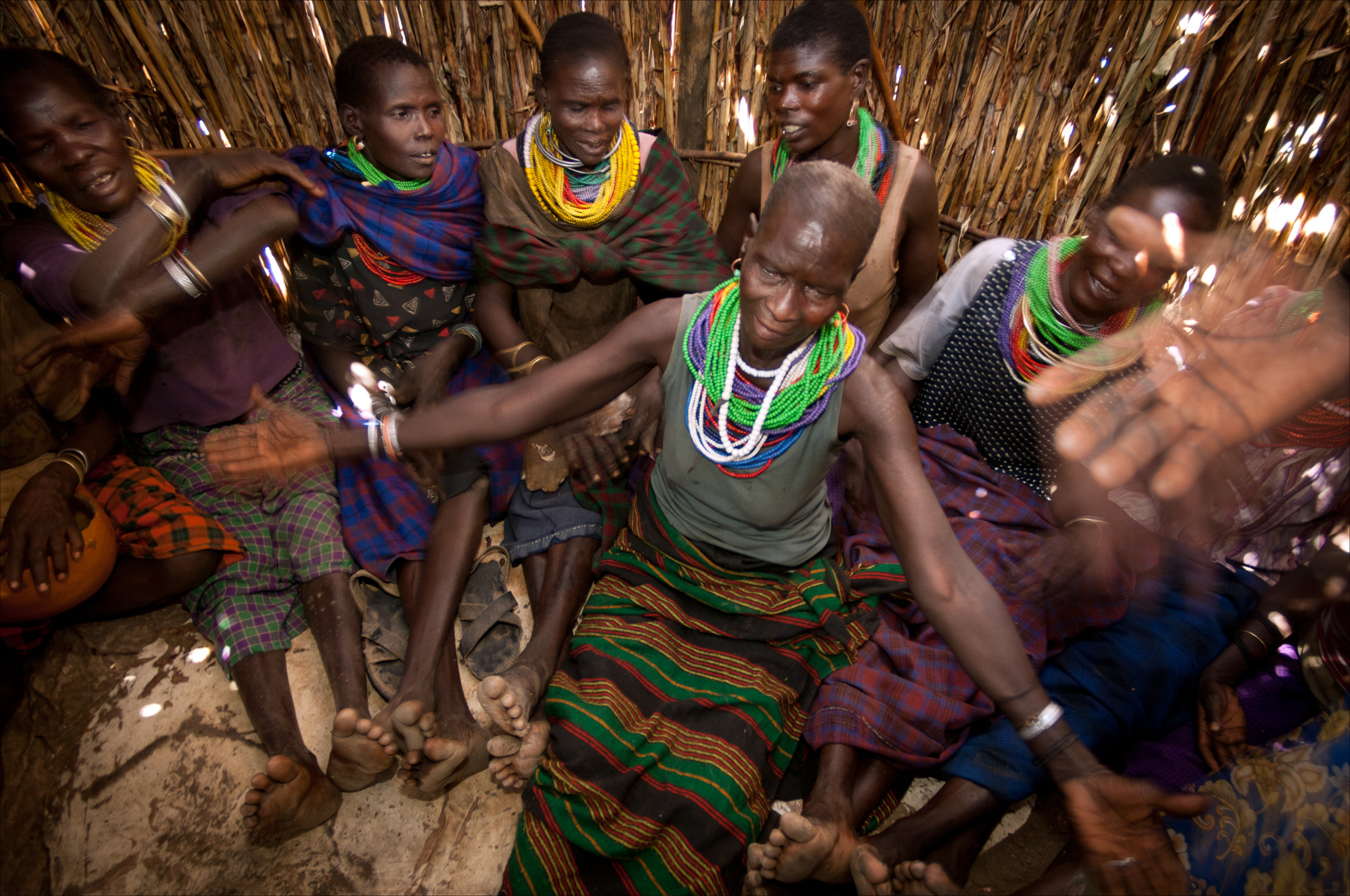 Women celebrate during a dowry ceremony. Wedding ceremonies are one of the most important celebrations in Karamajong culture and cannot take place unless the groom has enough cows and gifts to satisfy the family of the bride. Moroto, Uganda.