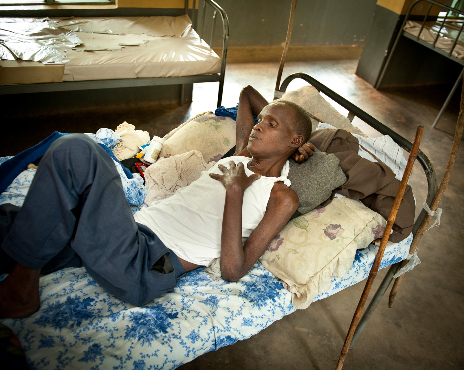 Eddy Bilak is treated at Nyapea Hospital in Uganda for complications due to HIV/AIDS and TB. Eddy is in a program with BRAC which will monitor him when he is released to see if that he is in compliance with his drug treatment. Drug resistant strains of TB are a concern worldwide.