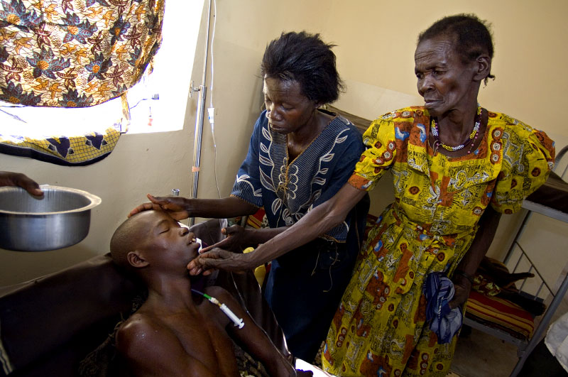 At Arua Hospital Irena Sakaru attends to her son Tiboa Richard, 26, who is critically ill with meningitis. Unfortunately Tiboa did not respond to the medication and passed away later that day.