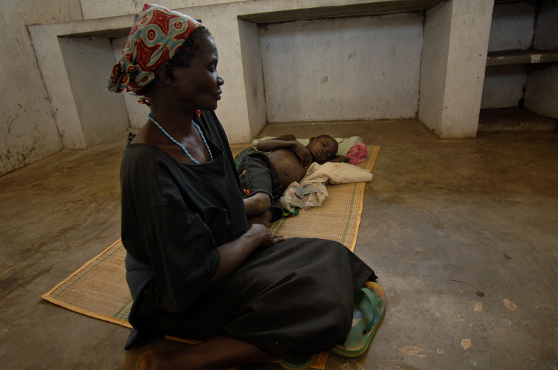 At Omugo Health Center in Aura District Candiru Susan brings her grandson Dramile Thomas, 9, for treatment.