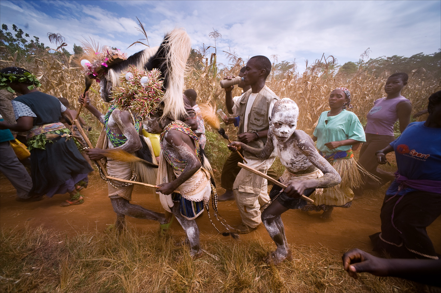 Namugali, 12 years, Numugali John, 11 years, Wameyo Geofery, 15 years, and Wameyo Bosco, 14 years, visit homes in their community hoping to get gifts on the day they are to be circumcised in Namakandwa Bukeka, Uganda. For the Bagisu, the dominant tribe in Eastern Uganda, circumcision is required for a young man to progress to adulthood. The boys are circumcised without anesthesia, if they move or cry out during the cutting they are viewed as a coward and shame their parents and ancestors and will never be viewed as an adult. Recent studies indicate that male circumcision can reduce HIV transmission by as much as 60 percent.