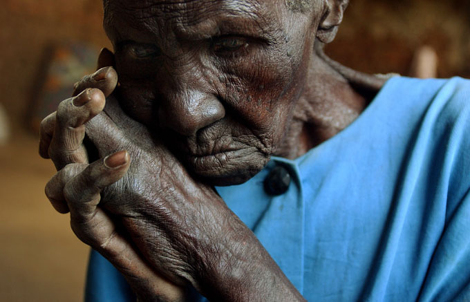 Ayuro Teddy does not know her age, relative's think she is about 75. Teddy walked 15 kilometers from her village to Soroti town after the Lord's Resistance Army repeatedly attacked her village. In the last several months the rebels killed her husband and brother when they were trying to flee the violence.