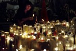 A woman weeps at a cadlelight vigil at Union Square.