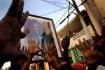 Haitians in Port Au Prince take to the streets in a fierce show of support for President Jean-Bertrand Aristide, who unexpectedly fled the country earlier in the day.