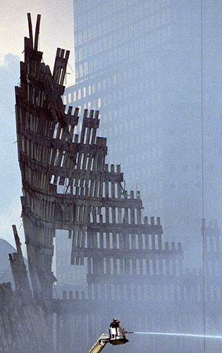 Firefighters work to extinguish fires at Ground Zero.