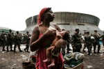 Quintella Willams holds her nine-day-old baby girl, Akea, outside of the Superdome sports complex in New Orleans, LA while waiting to be evacuted from the city.  Thousands of people continued to be left stranded days after Hurricane Katrina devastated the area.