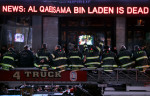 Firefighters from Engine Company 54 and Ladder 4, which share a firehouse in Midtown Manhattan in New York, NY, celebrate together just after midnight in Times Square on May 2, 2011, after it was announced that Osama Bin Laden had been killed in a U.S. military strike in Pakistan.   Fifteen firefighters from the Engine Company 54 and Ladder 4 firehouse died responding to the terrorist attacks on September 11, 2001.
