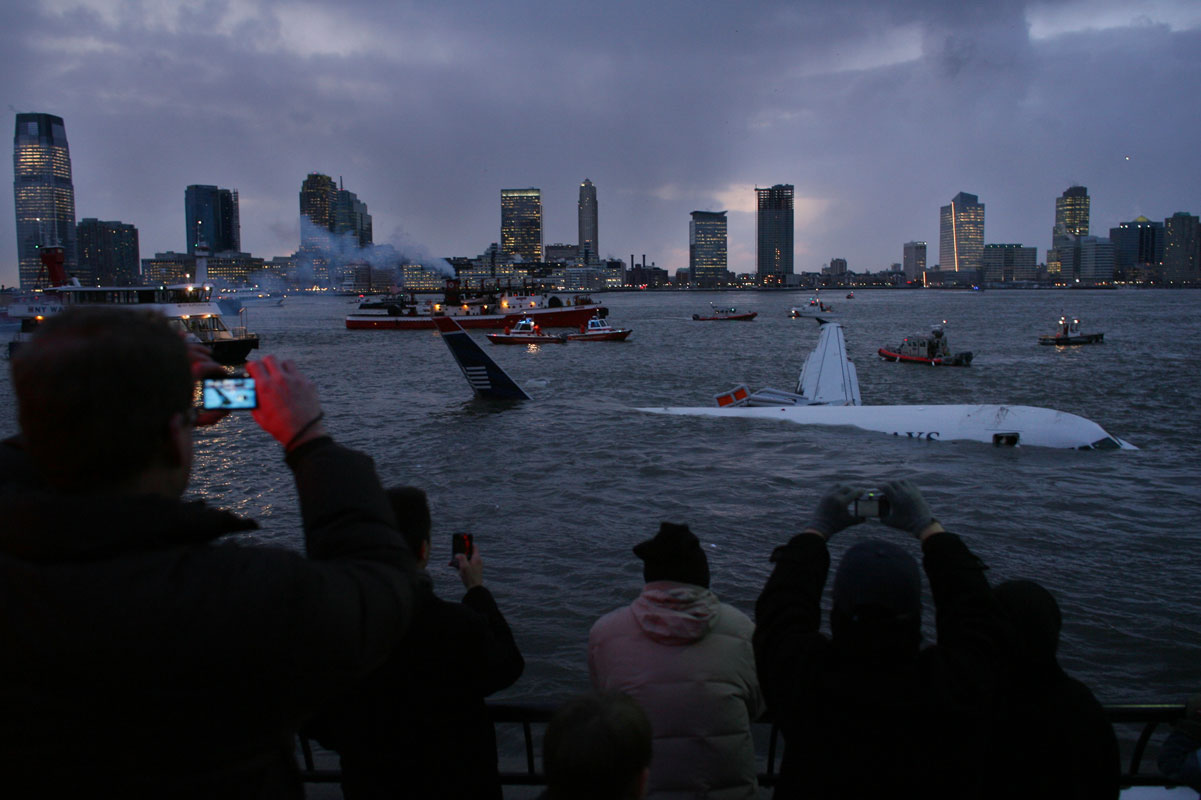 A US Airways jetliner, which was bound for Charlotte, NC, floats down the Hudson River off of Battery Park CIty in Manhattan after crash landing in the river just after takeoff from LaGuardia Airport on Jan.15, 2009.   After floating for down river the large plane hit land at Battery Park City where it was secured for removal from the water days later.