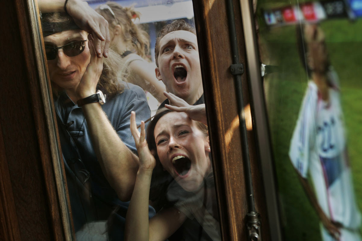 Fans of the French National soccer team react as they watch from outside a French bistro in Soho after a missed goal opportunity during the World Cup final against Italy. Their team would go on to lose the game.
