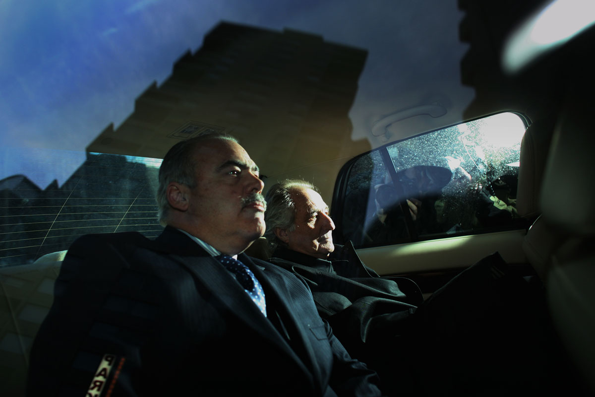 Bernard Madoff sits in a car as he leaves federal court in downtown Manhattan on Jan. 1, 2009, where he was being accused of running a $50 billion Ponzi scheme through his investment company.  Mr. Madoff  ultimately pled guilty to 11 federal felonies and was sentenced to 150 years in federal prison.